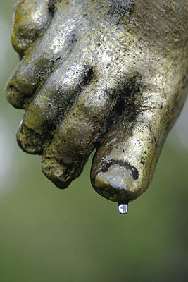 Waterdrop on the foot of a statue
