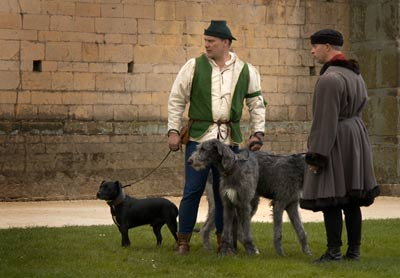 Servents walking dogs, Knights Tournament at Bolsover Castle