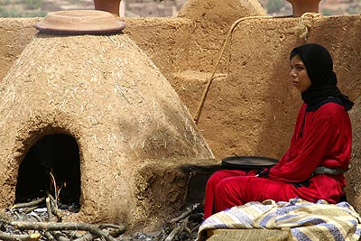 woman and clay oven, Marrakech
